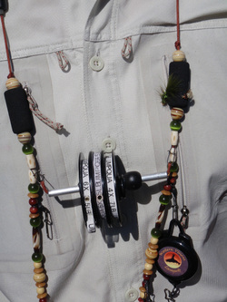 Fly fishing lanyard being worn with tippet spools and retractor.