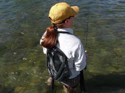 Fly fishing lanyard being worn and showing net attached.